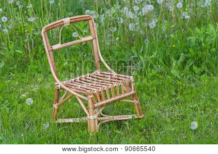 Wicker chair for kids in spring grass