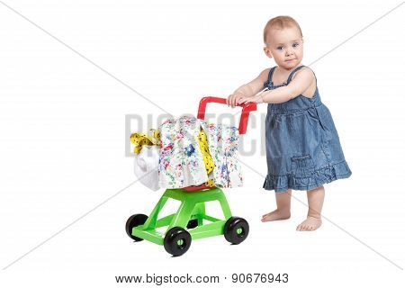 Child With A Toy Shopping Trolley