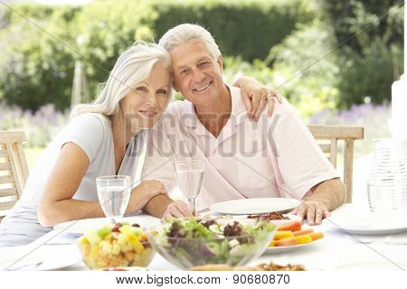 Senior couple enjoying al fresco meal