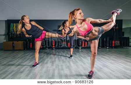 Women in a boxing class training high kick