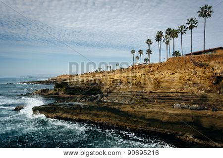 Waves Crashing On Cliffs Along The Pacific Ocean At Sunset Cliffs Natural Park, Point Loma, Californ