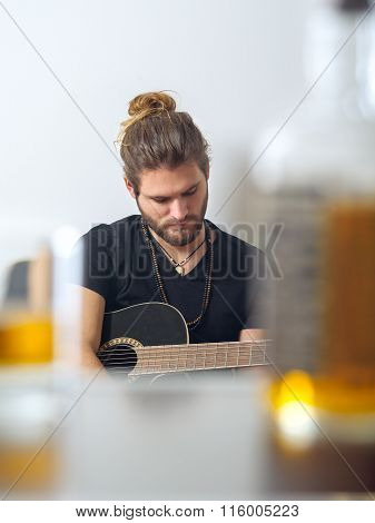 Songwriter Concentrating On Writing