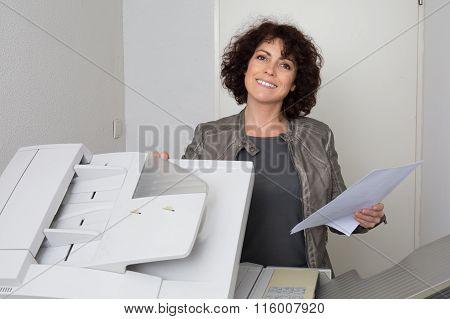 Happy Secretary Using A Copy Machine At Work