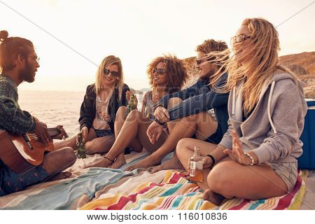 Young Friends Enjoying A Beach Party