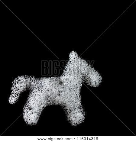 Soap foam horse silhouette. Suds, shower. Black background. soft focus, close-up, up view, copyspace