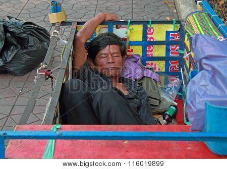 man is sleeping in trailor body