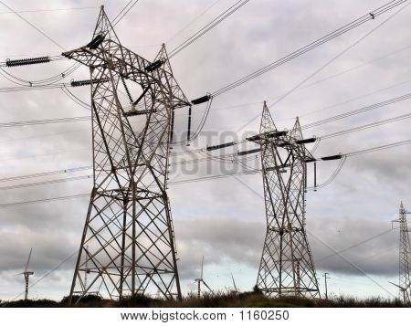 in the country a pylon and of the electric wire high tension poster