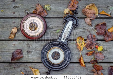Two Antique Barometers On Wood