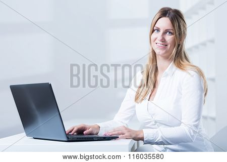 Image of tele consultant with laptop during work poster