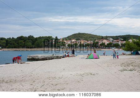 Town Beach In The Summer Day In Rovinj In Croatia