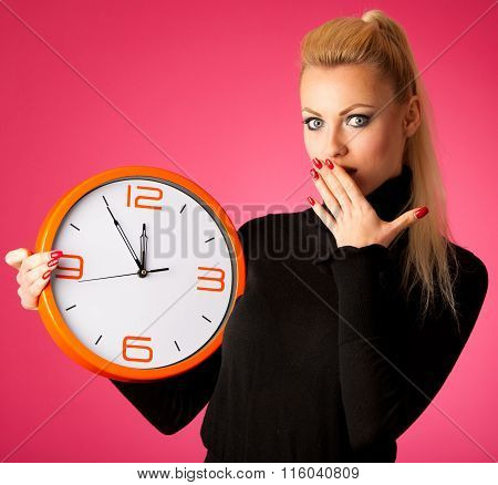 Worried Woman With Big Orange Clock Gesturing Delay, Rush, Nervous, Stress Because Of Lack Of Time.