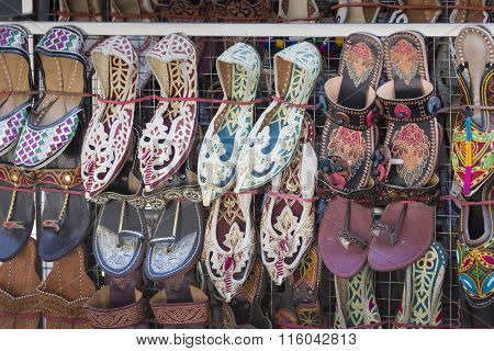 Traditional Nepali Hempen Shoes And Vest Leaning Against A Red Wall In A Shop In Durbar Square-kathm