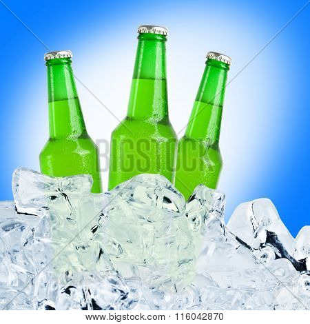 Three green bottles of beer on ice with a blue background.