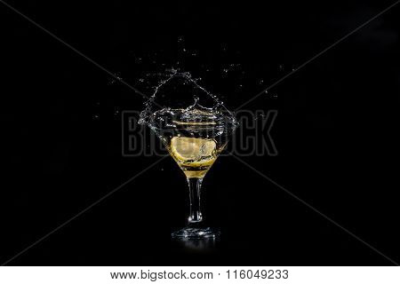 A Slice Of Lemon Dropped In A Glass Of Cocktail