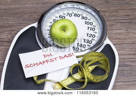 Concept photography for healthy life with apple bathroom scales and tape measure