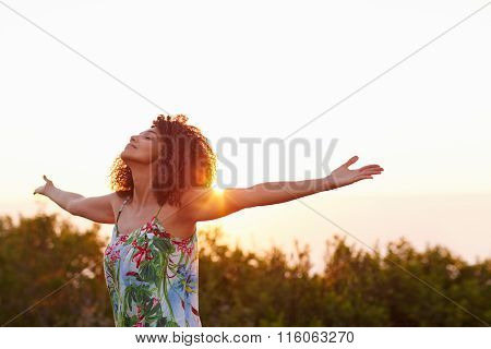 Woman with her arms outstretched in an expression of freedom