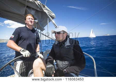 KYTHNOS, GREECE - CIRCA MAY, 2014: Sailors participate in sailing regatta 11th Ellada 2014 among Greek island group in the Aegean Sea, in Cyclades and Argo-Saronic Gulf.