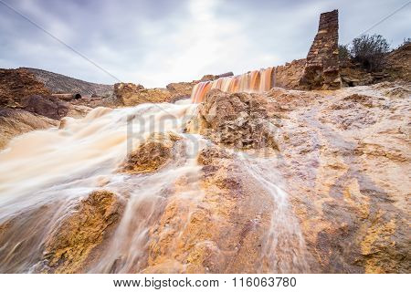 Waterfall in Riotinto mining area, Andalusia, Spain