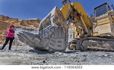 Young girl with big excavator