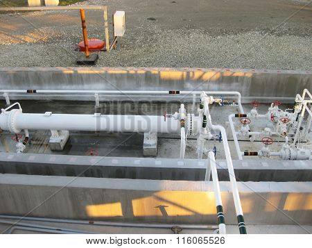 Heat exchangers in a refinery. The equipment for oil refining. poster