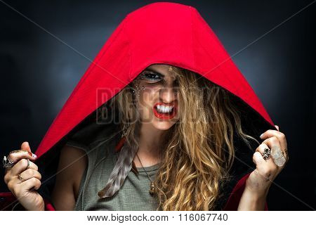 Girl In Red Hood And Makeup Scowling