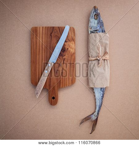 Fish Preservation Traditional Thai Food Dried Wahoos Or Scomberomorus Salted On Brown Paper Board .
