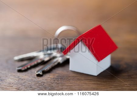 House Model And Keys On Table