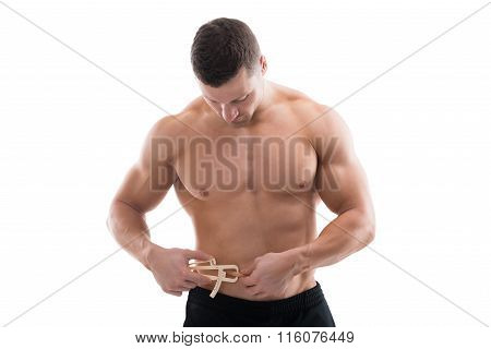 Muscular Man Measuring Fats With Caliper