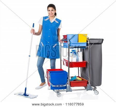 Happy Female Janitor Mopping By Trolley On White Background