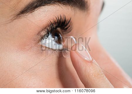 Woman Wearing Contact Lens At Home