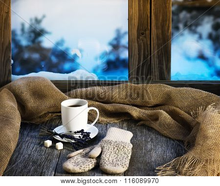 White Cup Of Coffee Or Tea, Lavender Flowers, Mittens And Natural Gunny Cloth.