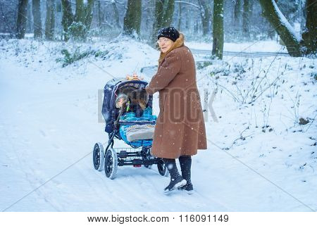 Grandmother walking with baby boy  in winter