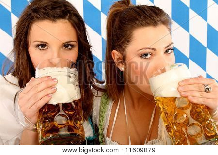 women with bavarian beer