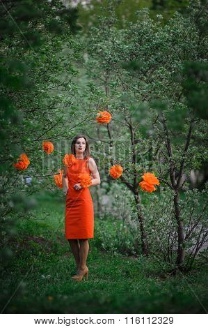 Beautiful Young Woman In A Spring Park With The Decor Pompons