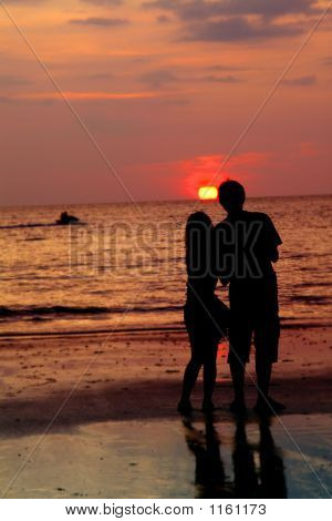 Loving Couple At Sunset