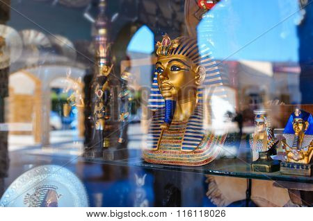 Egyptian Statue In The Storefront Behind The Glass