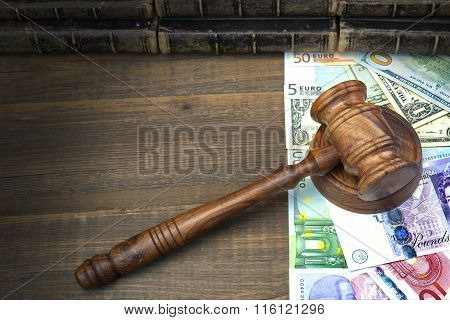 Judges Or Auctioneers Gavel, Dollars, Euro, Pounds On Wood Table