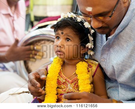 Baby girl received prayers from the karnvedh events. Traditional Indian Hindus ear piercing ceremony. India special rituals.