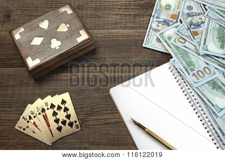 Two Unopened Playing Cards Deck, Money And Notepad On Table