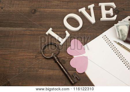 Wedding Concept. Hearts, Pen, Paper, Key, Money On Wood Background