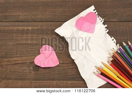 Unrequited Love Concept. Color Pencils, Two Crumpled Heart, Blank Page