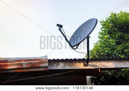 Disk Satellite On The Roof In Upcountry House