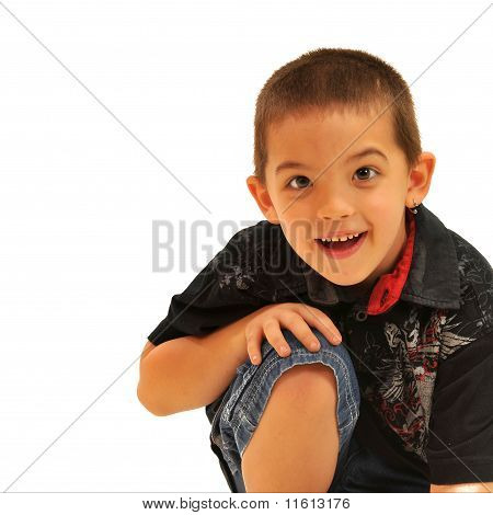 Smiling boy with hands on knee