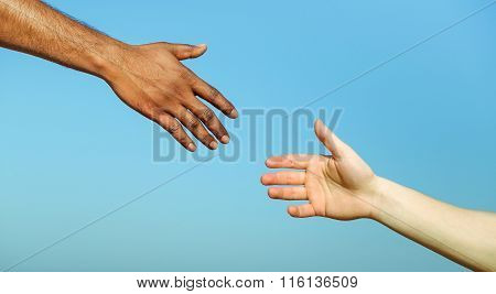 Black Hand Man Helping White Person - Different Skin Color Hands United Against Racism