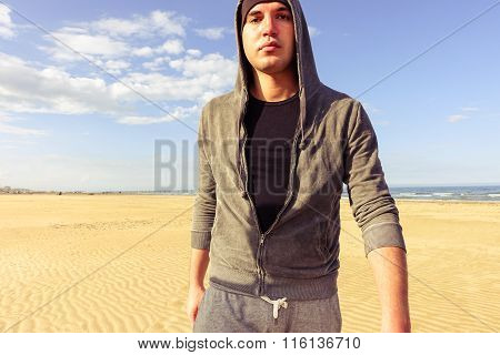 Young Sexy Tough Man Walking On The Beach