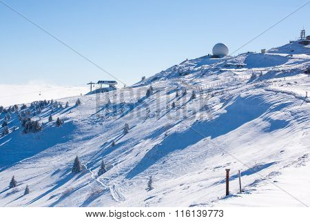 Vibrant panorama of the slope at ski resort Kopaonik, Serbia, snow pine trees, ski lift, blue sky poster