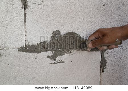 Hand Using Trowel With Wet Concrete To Plastering Lightweight Concrete Block, Foamed Concrete Block,
