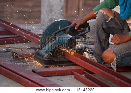 Cutting Steel channel (steel C chanel) with grinder. Sparks while grinding iron poster