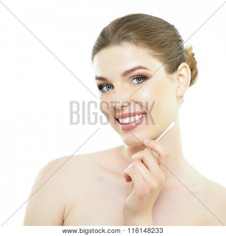 Portrait of attractive smiling girl holding wand for claning ears, over white background
