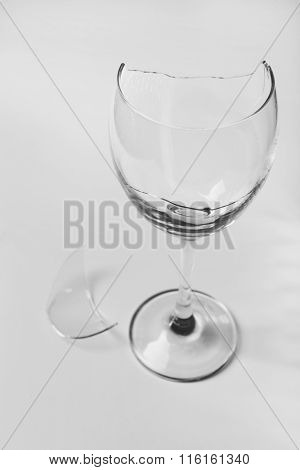 Broken wine glass isolated on white background